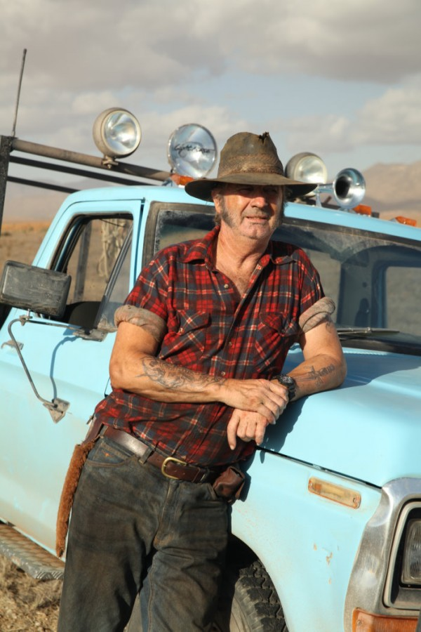 WolfCreek2_John Jarratt as Mick Taylor_with his hunting ute